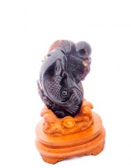 Mexican Amber Carving of Buddha and a Fish upon a detailed wood base