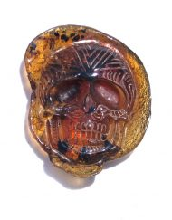 Hand Carved Skull Relief in Mexican Blue Green Amber 10.4 g