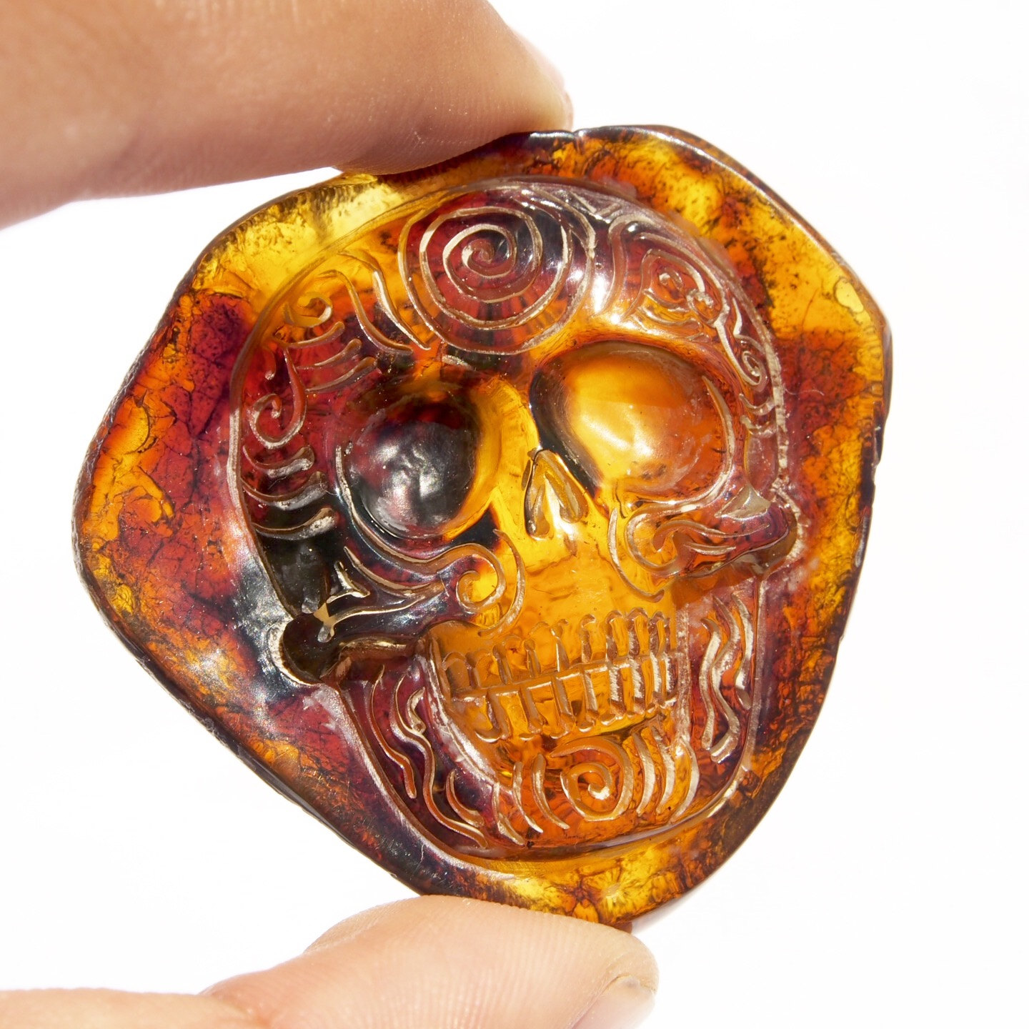 Hand carved skull relief in mexican blue green amber