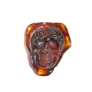 Hand Carved Skull Relief in Mexican Blue Green Amber 6.8 g, Grade B