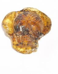 Hand Carved Skull Relief in Mexican Blue Green Amber 7.1 g, Grade B