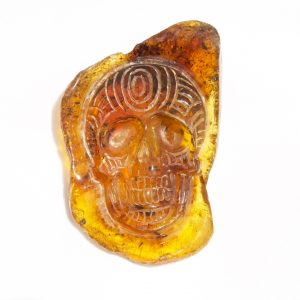 Hand Carved Skull Relief in Mexican Blue Green Amber 8.1 g, Grade B