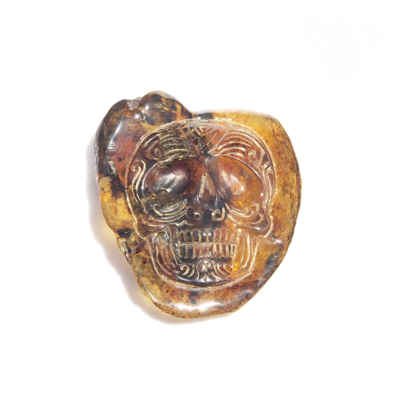 Hand carved skull relief in mexican blue green amber g