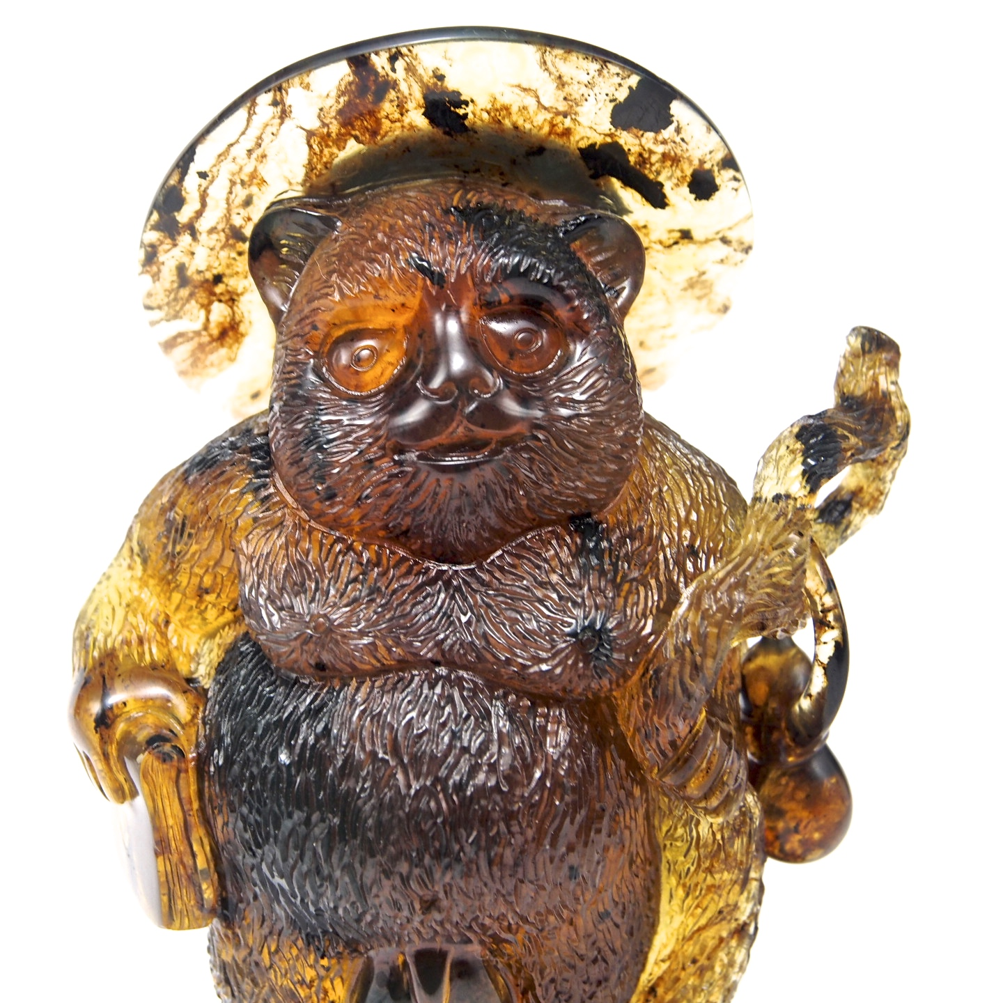 Mexican amber carving of Tanuki